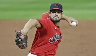 FILE - In this Wednesday, Aug. 5, 2020 file photo, Cleveland Indians relief pitcher Brad Hand delivers in the ninth inning in a baseball game against the Cincinnati Red in Cleveland. Brad Hand has agreed in principle to join the Washington Nationals, according to a person with knowledge of the deal. The person spoke to The Associated Press on condition of anonymity Sunday, Jan. 24, 2021 because the deal was still not official and is pending the successful completion of a physical exam. (AP Photo/Tony Dejak)