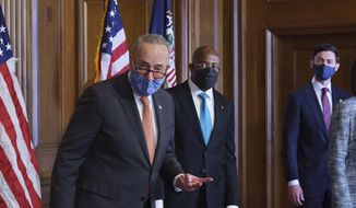On the first full day of the Democratic majority in the Senate, Majority Leader Chuck Schumer, D-N.Y., left, is joined by Sen. Raphael Warnock, D-Ga., center, and Sen. Jon Ossoff, D-Ga., during a press event at the Capitol in Washington, Thursday, Jan. 21, 2021. The pivotal Georgia runoff election this month was decisive in handing Democrats the majority in the Senate. (AP Photo/J. Scott Applewhite) **FILE**