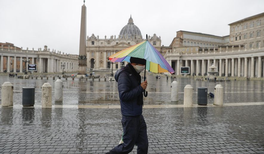 """A man walks past an almost empty St. Peter's Square at the Vatican, Sunday, Jan. 24, 2021. Ailing Pope Francis, making limited public appearances due to persistent pain, drew attention to the plight of homeless people in winter, including a Nigerian man who froze to death not far from the Vatican. Francis on Sunday asked for prayers for the man, who he said was 46, named Edwin, and who was """"ignored by all, abandoned, even by us."""" (AP Photo/Gregorio Borgia)"""
