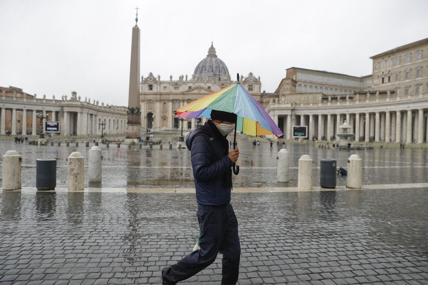 "A man walks past an almost empty St. Peter's Square at the Vatican, Sunday, Jan. 24, 2021. Ailing Pope Francis, making limited public appearances due to persistent pain, drew attention to the plight of homeless people in winter, including a Nigerian man who froze to death not far from the Vatican. Francis on Sunday asked for prayers for the man, who he said was 46, named Edwin, and who was ""ignored by all, abandoned, even by us."" (AP Photo/Gregorio Borgia)"