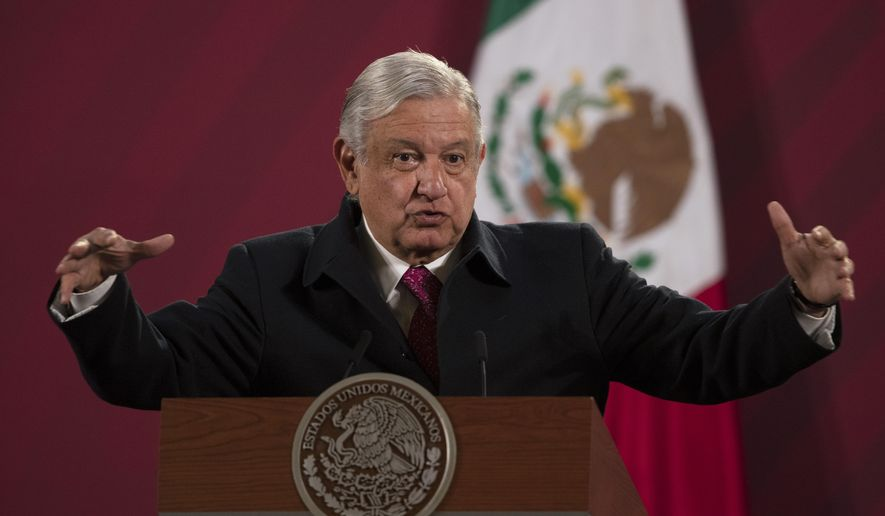 In this Dec. 18, 2020, file photo, Mexican President Andres Manuel Lopez Obrador gives his daily, morning news conference at the presidential palace, Palacio Nacional, in Mexico City. Mexico President Andrés Manuel López Obrador says he has tested positive for COVID-19 and is under medical treatment, Sunday, Jan. 24, 2021. (AP Photo/Marco Ugarte, File)
