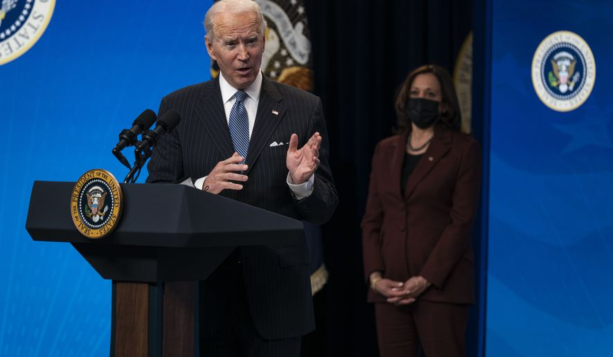 Vice President Kamala Harris listens as President Joe Biden answers questions from reporters in the South Court Auditorium on the White House complex, Monday, Jan. 25, 2021, in Washington. (AP Photo/Evan Vucci)
