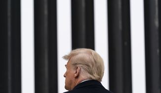 In this Jan. 12, 2021, photo, President Donald Trump tours a section of the U.S.-Mexico border wall in Alamo, Texas. During the Trump administration's final weeks, the Department of Homeland Security quietly signed agreements with at least four states that threaten to temporarily derail President Joe Biden's efforts to undo his predecessor's immigration policies. (AP Photo/Alex Brandon) **FILE**