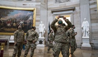 National Guard troops tour the Rotunda at the U.S. Capitol in Washington, during a break from reinforcing security, Monday, Jan. 25, 2021. (AP Photo/J. Scott Applewhite) **FILE**
