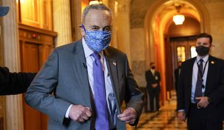 Senate Majority Leader Chuck Schumer of N.Y., heads to an interview on Capitol Hill in Washington, Monday, Jan. 25, 2021. (AP Photo/Susan Walsh)