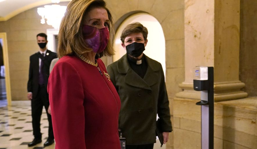 House Speaker Nancy Pelosi of Calif., walks to her office on Capitol Hill in Washington, Monday, Jan. 25, 2021, with retired Rear Adm. Margaret Kibben, right, the new House chaplain. (AP Photo/Susan Walsh)