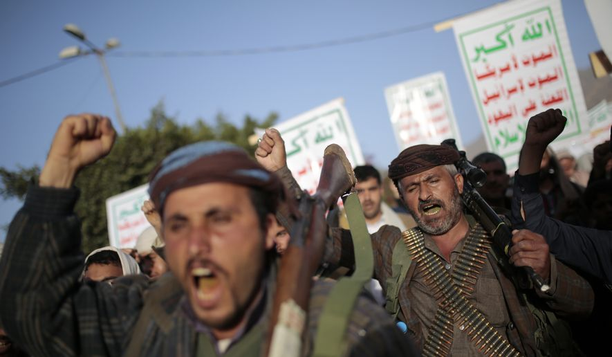Houthi supporters chant slogans as they attend a demonstration against the United States over its decision to designate the Houthis a foreign terrorist organization in Sanaa, Yemen, Monday, Jan. 25, 2021. (AP Photo/Hani Mohammed)