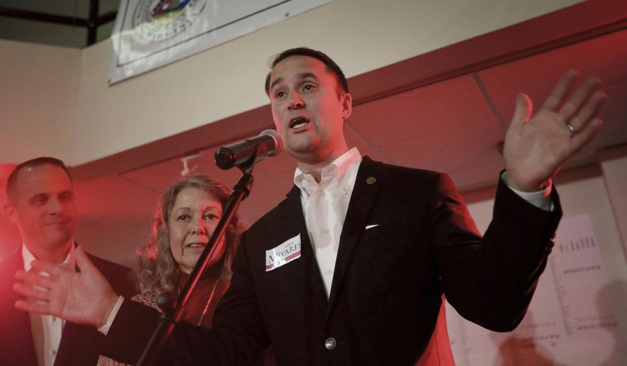 Delegate Jason Miyares claims victory in retaining his seat in the 82nd House District at the Republican victory party in Virginia Beach, Va. (Steve Earley/The Virginian-Pilot via AP)