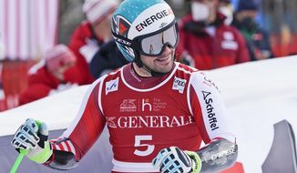 Austria's Vincent Kriechmayr celebrates at the finish area of an alpine ski, men's World Cup Super-G, in Kitzbuehel, Austria, Monday, Jan. 25, 2021. (AP Photo/Giovanni Auletta)