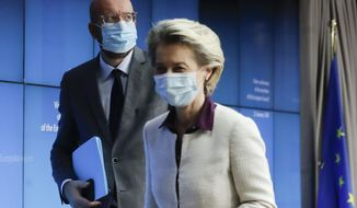 European Council President Charles Michel, left, and European Commission President Ursula von der Leyen leave after a joint news conference at the end of a EU summit video conference at the European Council headquarters in Brussels, Thursday, Jan. 21, 2021. European Union leaders assessed more measures to counter the spread of coronavirus variants during a video summit Thursday as the bloc's top disease control official said urgent action was needed to stave off a new wave of hospitalizations and deaths. (Olivier Hoslet, Pool Photo via AP)