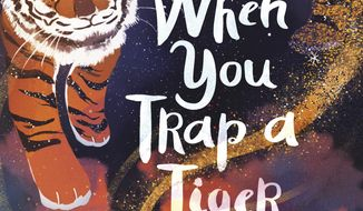 """This cover image released by Random House Books for Young Readers shows """"When You Trap a Tiger,"""" winner of the John Newbery Medal for the outstanding children's book overall of 2020. (Random House Books for Young Readers via AP)"""