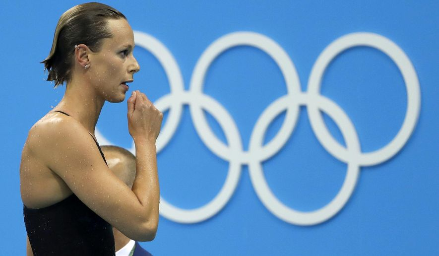 FILE - In this Aug. 8, 2016 file photo, Italy's Federica Pellegrini checks her time after placing third in a semifinal of the women's 200-meter freestyle during the swimming competitions at the 2016 Summer Olympics, in Rio de Janeiro, Brazil. The International Olympic Committee is slated in January 2021 to consider imposing a humiliating probation on Italy's team for the Tokyo Games due to a two-year domestic dispute that it says amounts to government interference. (AP Photo/Matt Slocum, file)