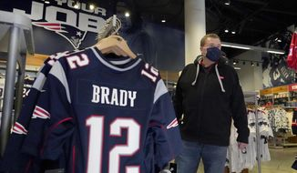 Football fan Brian Pope browses for Tom Brady jerseys in the pro shop at Gillette Stadium, Monday, Jan. 25, 2021, in Foxborough, Mass. Tom Brady is going to the Super Bowl for the 10th time, and New England Patriots football fans are cheering for him -- just like before. (AP Photo/Elise Amendola)