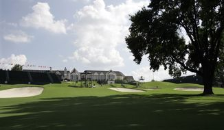 FILE - In this Aug. 5, 2007, file photo, the 18th fairway with the Southern Hills Country Club clubhouse visible is viewed at the 89th PGA Golf Championship in Tulsa, Okla. The 2022 PGA Championship, originally scheduled for Trump National in New Jersey, will be played at Southern Hills. (AP Photo/Rob Carr, File)