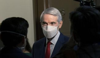 FILE - In this Jan. 19, 2021 file photo, Sen. Rob Portman, R-Ohio, speaks to members of the media outside a Senate Finance Committee hearing on Capitol Hill in Washington. Portman said Monday, Jan. 25 that he won't seek reelection and plans to end a career in federal government spanning more than three decades. (AP Photo/Andrew Harnik, File)