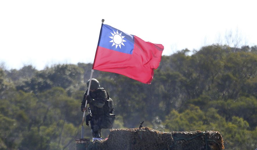 A soldier holds a Taiwan national flag during a military exercise in Hsinchu County, northern Taiwan, Tuesday, Jan. 19, 2021. (AP Photo/Chiang Ying-ying)  **FILE**