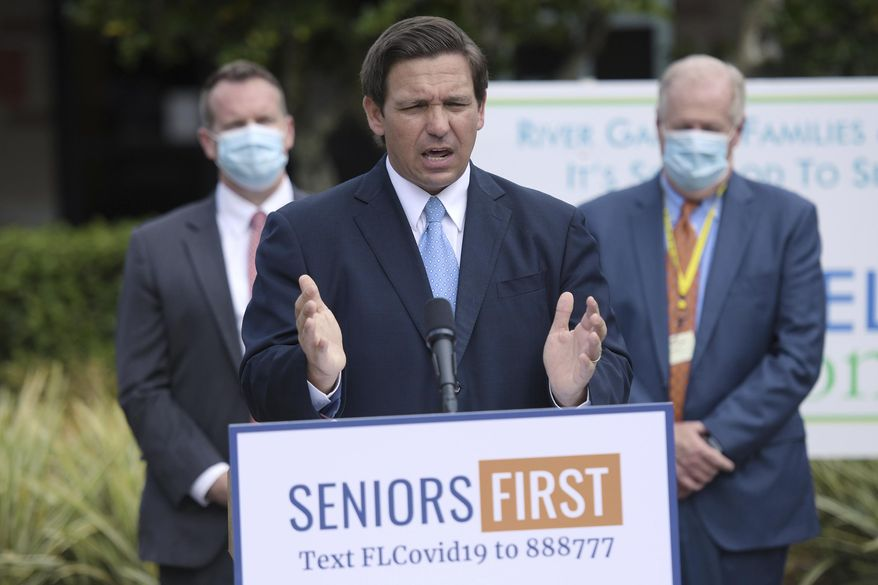Florida Gov. Ron DeSantis addressed the media at the River Garden Hebrew House for the Aged in Jacksonville, Fla., on the status of COVID-19 vaccination rates in the state's nursing homes and assisted living facilities Monday, Jan. 25, 2021. (Bob Self/The Florida Times-Union via AP)