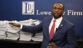 FILE - In this Aug. 29, 2019, file photo, Oklahoma state Rep. Jason Lowe, D-Oklahoma City, gestures to a stack of petitions during a news conference in Oklahoma City. Oklahomans would be required to wear masks in public and face up to $1,000 fines for failing to do so under a bill that's been filed by State Rep. Lowe as he announced Monday, Jan. 25, 2021, that he'd filed the bill.(AP Photo/Sue Ogrocki File)