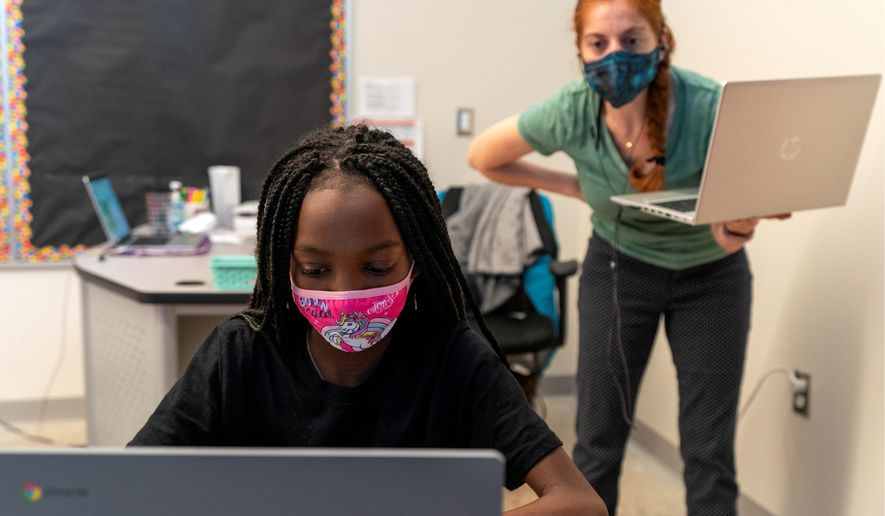 While D.C. teachers are eligible for the coronavirus shot, child care workers aren't. (Associated Press)