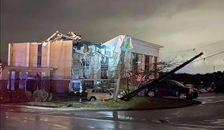 A Hampton Inn hotel is severely damaged after a tornado tore through Fultondale, Ala., on Monday, Jan. 25, 2021. (Alicia Elliott via AP) (ASSOCIATED PRESS)