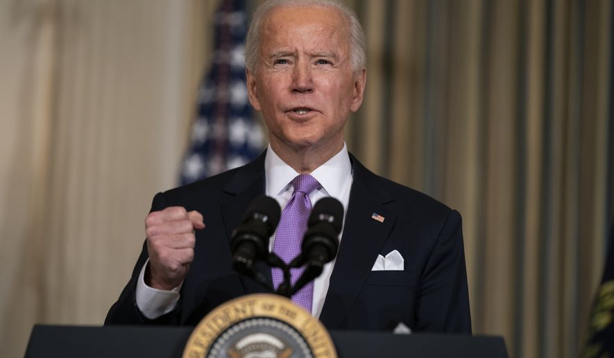 President Joe Biden delivers remarks on racial equity, in the State Dining Room of the White House, Tuesday, Jan. 26, 2021, in Washington. (AP Photo/Evan Vucci)
