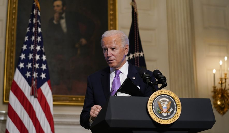 President Joe Biden leaves after delivering remarks on COVID-19, in the State Dining Room of the White House, Tuesday, Jan. 26, 2021, in Washington. (AP Photo/Evan Vucci)