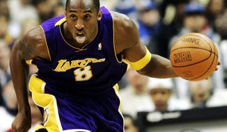 Los Angeles Lakers' Kobe Bryant dribbles the ball against the Washington Wizards during the second quarter in an NBA basketball game, Monday, Dec. 26, 2005, in Washington. (AP Photo/Evan Vucci)