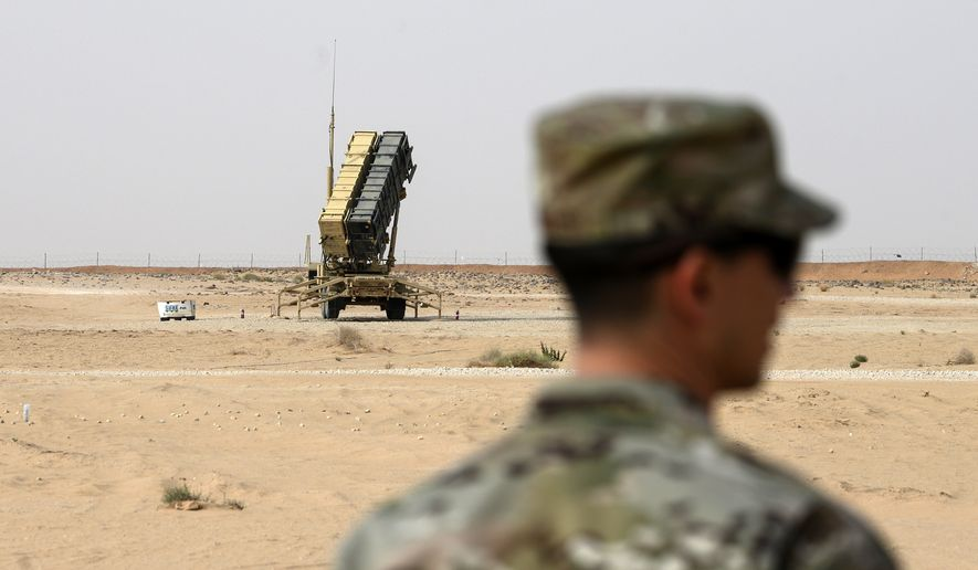 In this Feb. 20, 2020, file photo, a member of the U.S. Air Force stands near a Patriot missile battery at the Prince Sultan Air Base in al-Kharj, Saudi Arabia. The U.S. military is exploring the possibility using a Red Sea port in Saudi Arabia and an additional two airfields there amid heightened tensions with Iran, the military said Tuesday, Jan. 26, 2021. (Andrew Caballero-Reynolds/Pool via AP, File)