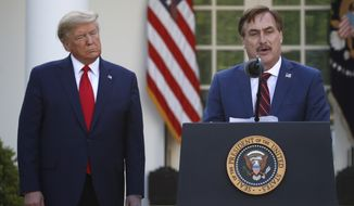In this March 30, 2020, photo, My Pillow CEO Mike Lindell speaks as President Donald Trump listens during a briefing about the coronavirus in the Rose Garden of the White House, in Washington. (AP Photo/Alex Brandon) **FILE**