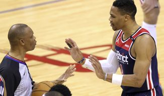 Washington Wizards' Russell Westbrook questions referee Michael Smith during the fourth quarter of the team's NBA basketball game against the Houston Rockets on Tuesday, Jan. 26, 2021, in Houston. (Carmen Mandato/Pool Photo via AP)