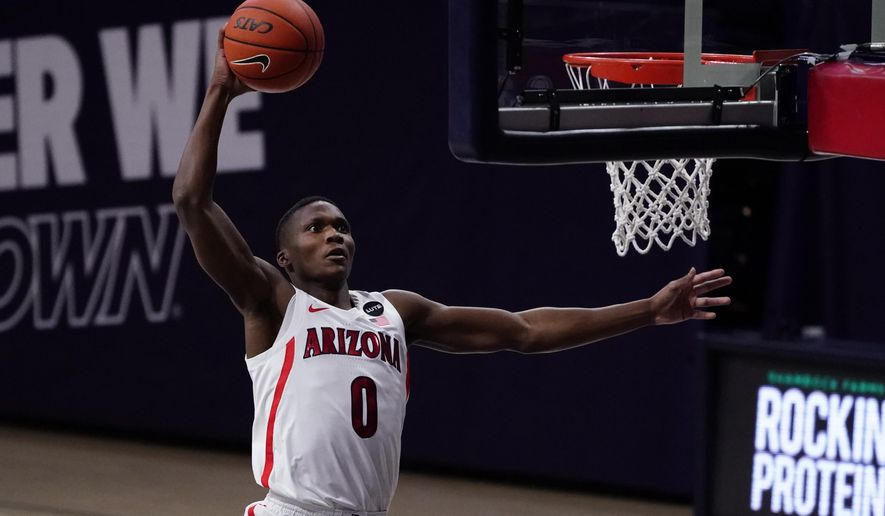 Arizona guard Bennedict Mathurin (0) dunks against Arizona State during the first half of an NCAA college basketball game, Monday, Jan. 25, 2021, in Tucson, Ariz. (AP Photo/Rick Scuteri)