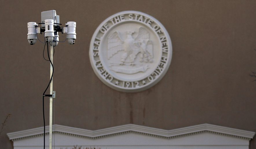 Mobile police surveillance cameras watch over the entrance to the New Mexico State Capitol during the annual legislative session on Monday, Jan. 25, 2021, in Santa Fe, N.M. (AP Photo/Cedar Attanasio)