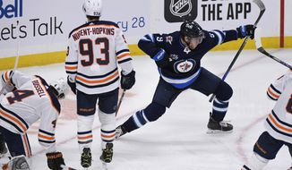 Winnipeg Jets' Andrew Copp (9) celebrates his goal against the Edmonton Oilers during the first period of an NHL hockey game Tuesday, Jan. 26, 2021, in Winnipeg, Manitoba. (Fred Greenslade/The Canadian Press via AP)