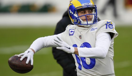 Los Angeles Rams quarterback Jared Goff warms up before an NFL divisional playoff football game against the Green Bay Packers, Saturday, Jan. 16, 2021, in Green Bay, Wis. (AP Photo/Matt Ludtke)