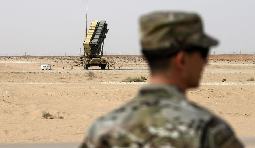 FILE - In this Feb. 20, 2020 file photo, a member of the U.S. Air Force stands near a Patriot missile battery at the Prince Sultan Air Base in al-Kharj, Saudi Arabia. The U.S. military is exploring the possibility using a Red Sea port in Saudi Arabia and an additional two airfields there amid heightened tensions with Iran, the military  said Tuesday, Jan. 26, 2021. (Andrew Caballero-Reynolds/Pool via AP, File)