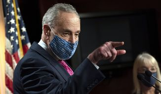 Senate Majority Leader Chuck Schumer of N.Y., left, speaks during a news conference with Sen. Patty Murray, D-Wash., right, Tuesday, Jan. 26, 2021, on Capitol Hill in Washington. (AP Photo/Jacquelyn Martin)