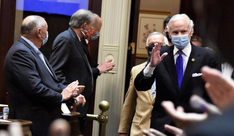 South Carolina Gov. Henry McMaster, right, waves as he walks into the state House chamber for his State of the State address on Wednesday, Jan. 13, 2021, in Columbia, S.C. (AP Photo/Meg Kinnard)