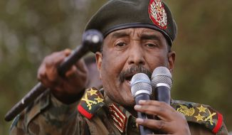 FILE - In this June 29, 2019 file photo, Sudanese Gen. Abdel-Fattah Burhan, head of the military council, speaks during a military-backed rally, in Omdurman district, west of Khartoum, Sudan. An Israeli delegation headed by Intelligence Minister Eli Cohen quietly visited Sudan and met with Burhan, officials from both countries said Tuesday, Jan. 26, 2021. The visit on Monday was the first visit by an Israeli minister to Sudan less than three weeks after Khartoum inked an agreement to normalize ties with Israel. (AP Photo/Hussein Malla, File)