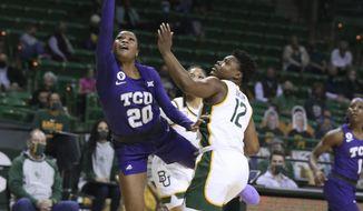 TCU guard Lauren Heard, left, shoots over Baylor guard Moon Ursin during the first half of an NCAA college basketball game Tuesday, Jan. 26, 2021, in Waco, Texas. (Rod Aydelotte/Waco Tribune Herald via AP)