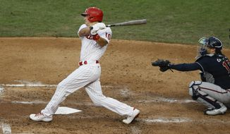 FILE - Philadelphia Phillies' J.T. Realmuto follows through after hitting a two-run home run off Atlanta Braves pitcher Robbie Erlin during the fourth inning of a baseball game in Philadelphia, in this Monday, Aug. 10, 2020, file photo. Realmuto is a free agent. (AP Photo/Matt Slocum, File)