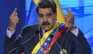 Venezuelan President Nicolas Maduro speaks during a ceremony marking the start of the judicial year at the Supreme Court in Caracas, Venezuela, Friday, Jan. 22, 2021. (AP Photo/Matias Delacroix)