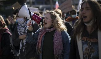 Students chant slogans during a demonstration in Marseille, southern France, Tuesday Jan. 26, 2021. Teachers and university students marched together in protests or went on strike Tuesday around France to demand more government support amid the pandemic. (AP Photo/Daniel Cole)