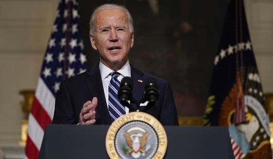 President Joe Biden delivers remarks on climate change and green jobs, in the State Dining Room of the White House, Wednesday, Jan. 27, 2021, in Washington. (AP Photo/Evan Vucci)