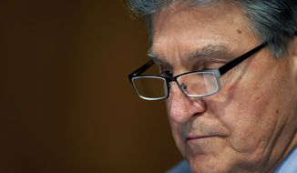 Sen. Joe Manchin, D-W.Va., listens during a confirmation hearing for Secretary of Veterans Affairs nominee Denis McDonough before the Senate Committee on Veterans' Affairs on Capitol Hill, Wednesday, Jan. 27, 2021, in Washington. (Leigh Vogel/Pool via AP) **FILE**