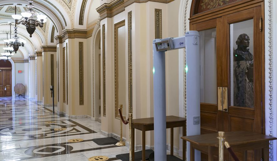 Members of the House of Representatives must now pass through a security check with metal detectors before entering the chamber, a new safety measure put into place after a mob loyal to President Donald Trump stormed the Capitol January 6, in Washington, at the Capitol in Washington, Wednesday, Jan. 27, 2021. (AP Photo/J. Scott Applewhite)