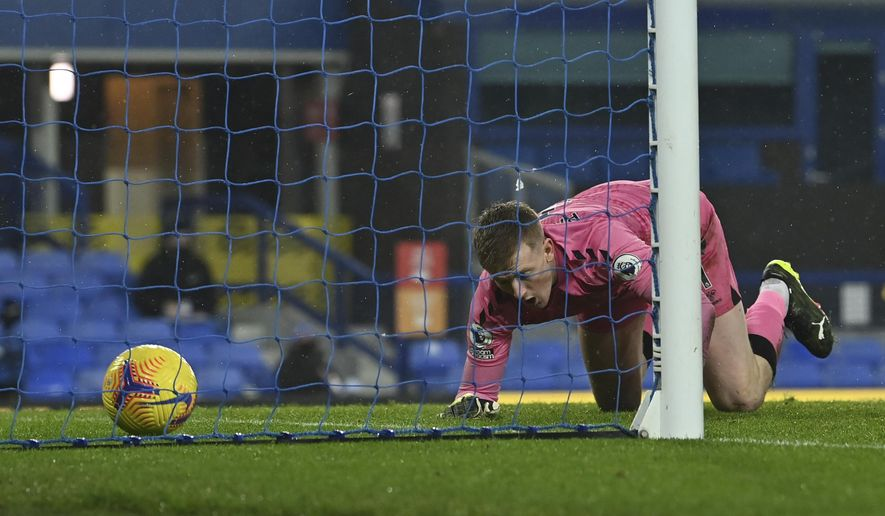 Everton's goalkeeper Jordan Pickford fals to same the shot by Leicester's Youri Tielemans who scored his side's opening goal during the English Premier League match between Everton and Leicester City at the Goodison Park stadium in Liverpool, England, Wednesday, Jan. 27, 2021. (Paul Ellis/Pool via AP)