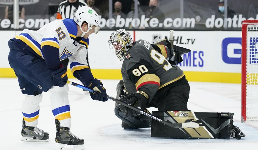 CORRECTS TO SHOOTOUT, INSTEAD OF OVERTIME - St. Louis Blues center Brayden Schenn (10) scores on Vegas Golden Knights goaltender Robin Lehner (90) in the shootout of an NHL hockey game Tuesday, Jan. 26, 2021, in Las Vegas. (AP Photo/John Locher)