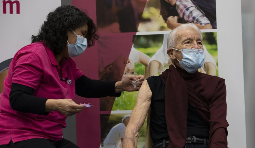 Jos Bieleveldt, 91, receives a COVID-19 vaccine in Apeldoorn, Netherlands, Tuesday, Jan. 26, 2021. Jos Bieleveldt had a spring in his 91-year-old step when he became one of the first Dutch recipients in his age group to get the coronavirus vaccine. One thing though, it really took too long a time coming. The 27-nation EU is coming under criticism for the slow rollout of its vaccination campaign. The bloc, a collection of many of the richest countries in the world, is not faring well in comparison to countries like Israel, the United Kingdom and the United States. (AP Photo/Peter Dejong)