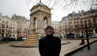 """Omer Mas Capitolin poses in Paris, Tuesday Jan.26, 2021. In a first for France, six nongovernmental organizations launched a class-action lawsuit Wednesday against the French government for alleged systemic discrimination by police officers carrying out identity checks. Omer Mas Capitolin, the head of Community House for Supportive Development, a grassroots NGO taking part in the legal action, called it a """"mechanical reflex"""" for French police to stop non-whites, a practice he said is damaging to the person being checked and ultimately to relations between officers and the members of the public they are expected to protect. (AP Photo/Christophe Ena)"""