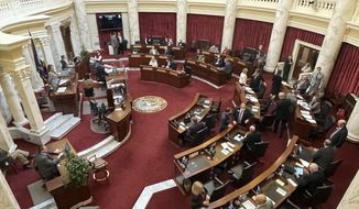 FILE - In this Friday, Jan. 15, 2021, file photo, the Idaho Senate gathers in the Statehouse in Boise, Idaho. Two former Republican speakers of the Idaho House of Representatives say attempts by the Republican-dominated House and Senate to strip Republican Gov. Brad Little and future governors of emergency powers endanger Idaho residents. (AP Photo/Keith Ridler, File)